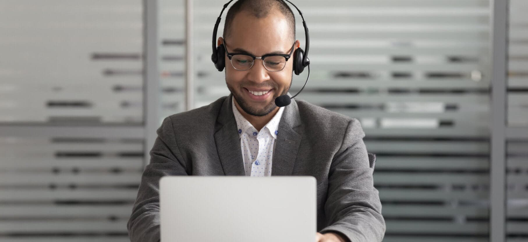 cheerful african american support service male worker consulting corporate customer