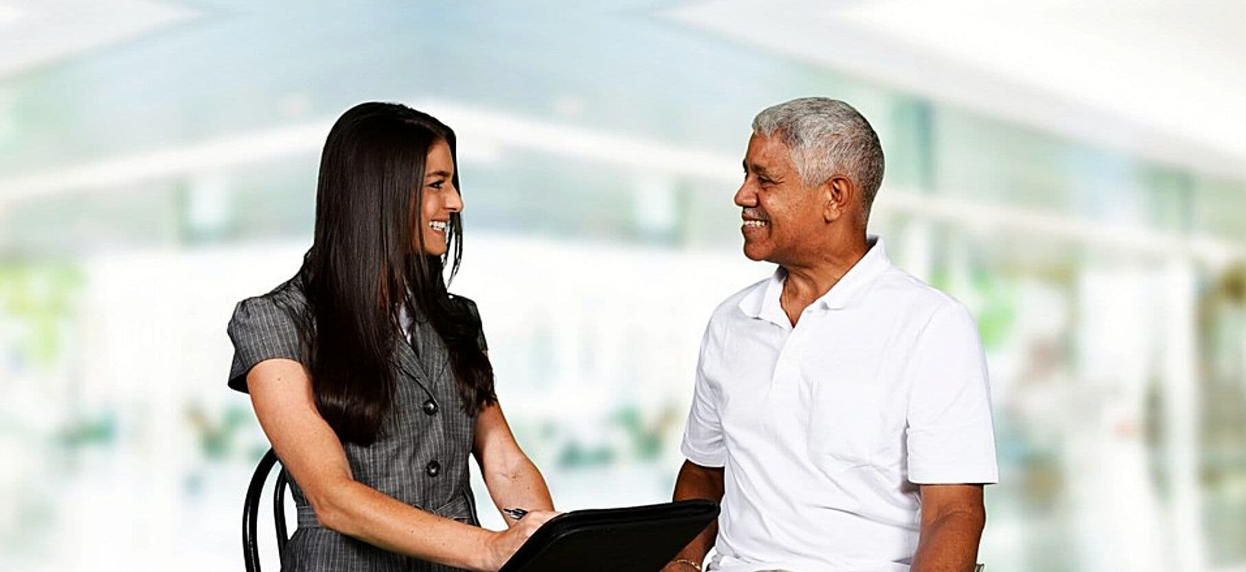 adult woman and senior man looking at each other while smiling